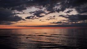 Solnedgång och moln Arkivfoto