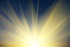 Solnedgång och moln Arkivbild