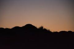 Solnedgång och resningen av månen Arkivbilder