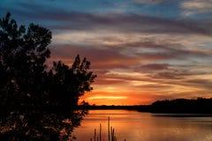 Solnedgång och silhouette Royaltyfri Fotografi
