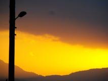 Solnedgång- och staketpöl Royaltyfri Bild