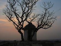 Solnedgång och tempel i Hampi Arkivbilder