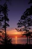 Solnedgång och vitt hav i sommarsäsong Arkivbilder