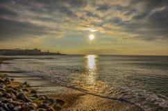 Solnedgång på Aberystwyth, Wales Royaltyfri Bild