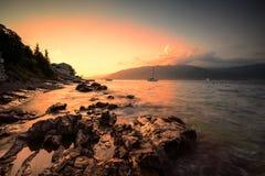 Solnedgång på Adriatiska havet Arkivfoto