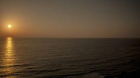 Solnedgång på Apollonia Beach Royaltyfri Foto