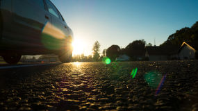 Solnedgång på asfalten Royaltyfri Foto