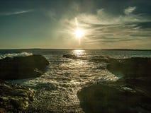 Solnedgång på Beavertail royaltyfri bild