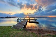 Solnedgång på Belmont, sjö Macquarie, NSW Australien Fotografering för Bildbyråer