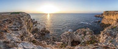 Solnedgång på capoen Mannu, Sardinia Arkivfoton