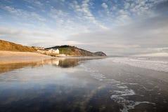 Solnedgång på Charmouth på Dorset den Jurassic kusten Fotografering för Bildbyråer