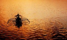 Solnedgång på Coron port Royaltyfria Bilder