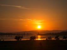Solnedgång på Danube River på Moldavien Noua Royaltyfria Bilder