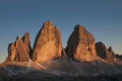 Solnedgång på de tre maxima av den Lavaredo dolomiten Arkivbilder