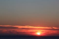 Solnedgång på den Ameland ön, Nederländerna Arkivfoto