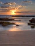 Solnedgång på den Birubi stranden, Australien royaltyfri bild