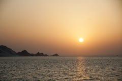 Solnedgång på den Detwah lagun Arkivfoto