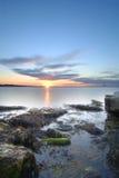 Solnedgång på den Dublin fjärden Arkivbild