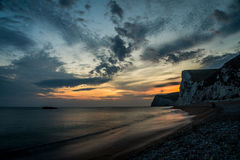 Solnedgång på den Durdle dörren, England, UK Royaltyfri Foto
