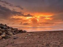 Solnedgång på den Glagah stranden Royaltyfria Foton