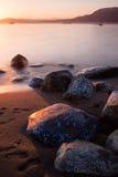 Solnedgång på den Kitsilano stranden Arkivfoton