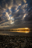 Solnedgång på den konstgjorda behållaren Geeste, Tyskland Fotografering för Bildbyråer