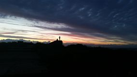 Solnedgång på den norr Norfolk kusten Arkivfoto