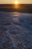 Solnedgång på den salta sjön av Elton Royaltyfria Bilder