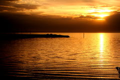 Solnedgång på den Sandringham fjärden Royaltyfria Bilder