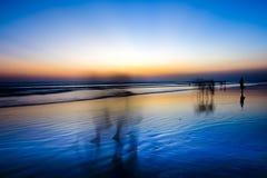 Solnedgång på den Seminyak stranden Bali Royaltyfri Foto
