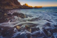 Solnedgång på den Terranea stranden royaltyfri foto