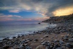 Solnedgång på den Terranea stranden arkivfoto