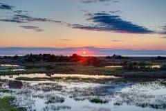 Solnedgång på det solitt Arkivfoto