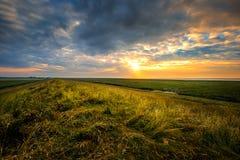 Solnedgång på diket nära Ostbense Royaltyfri Foto