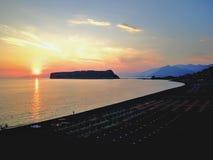 Solnedgång på Dino Island Royaltyfri Fotografi