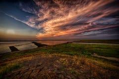 Solnedgång på Dollarden, det wadden havet arkivfoton
