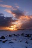 Solnedgång på Dyrholaey Royaltyfri Bild