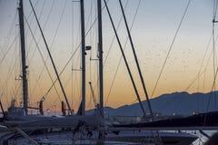 Solnedgång på en port Royaltyfria Foton