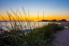 Solnedgång på fjärden Fotografering för Bildbyråer