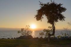 Solnedgång på fjärdframdelen Arkivfoton