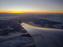 Solnedgång på 33.000 fot Royaltyfria Bilder