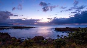 Solnedgång på hajs liten vik, norr kust, HI Arkivbilder