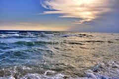 Solnedgång på havet Agecom Royaltyfri Foto