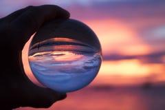 Solnedgång på havet till och med den Glass bollen Royaltyfria Bilder