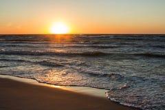 Solnedgång på havskusten, Arkivfoto