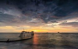 Solnedgång på Jeram Arkivfoto
