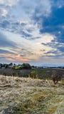 Solnedgång på kullen Arkivfoton