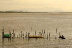 Solnedgång på lagun Arkivbild