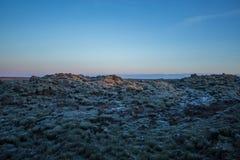 Solnedgång på lavafält i södra Island Arkivbilder