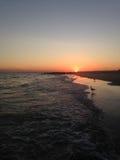 Solnedgång på Long Beach Royaltyfri Bild